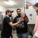 Dr. Guertin-Martin, two students and Crooked Eye Brewery brewer examine beer