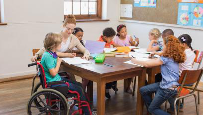 female instructor sitting at table with diverse students