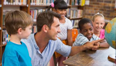 Male educator with diverse young students